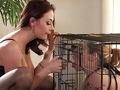 Women on brazen heels in super intense caged femdom