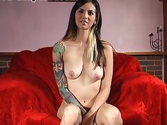Tattooed cutie Holly D takes off her clothes to masturbate more than the sofa