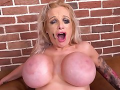 Bitch with big breasts chokes on black dick and gets it in her ass