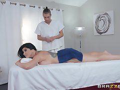 During the massage Romi Rain gets the brush pussy banged by a therapist