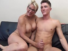 Mature light-haired female with glasses is fumbling her step- sonny's man meat after wall it a pile