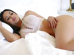 Dressed in lacy namby-pamby lingerie sexpot Kaylani Lei is fucked missionary hard
