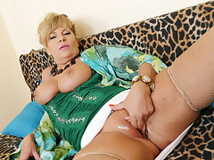 Euro milf Ellis Shine rubs her shaven pussy