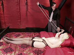 Undersized light-complexioned slave Samantha Rone headed up to the bed and pleasured