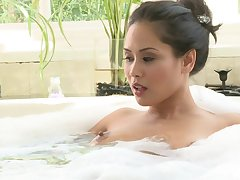 Asian pornstar Jessica Bangkok gives a blowjob and earns cum primarily tits