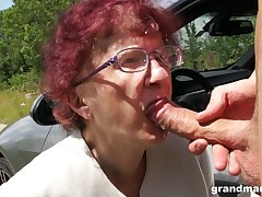 Weirdo granny gives a blowjob coupled with tugjob to one spoilt young guy