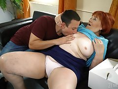 Mature redhead Marsha enjoys coitus to a younger suitor