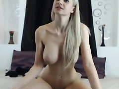 mart beauty with big tits rides dildo